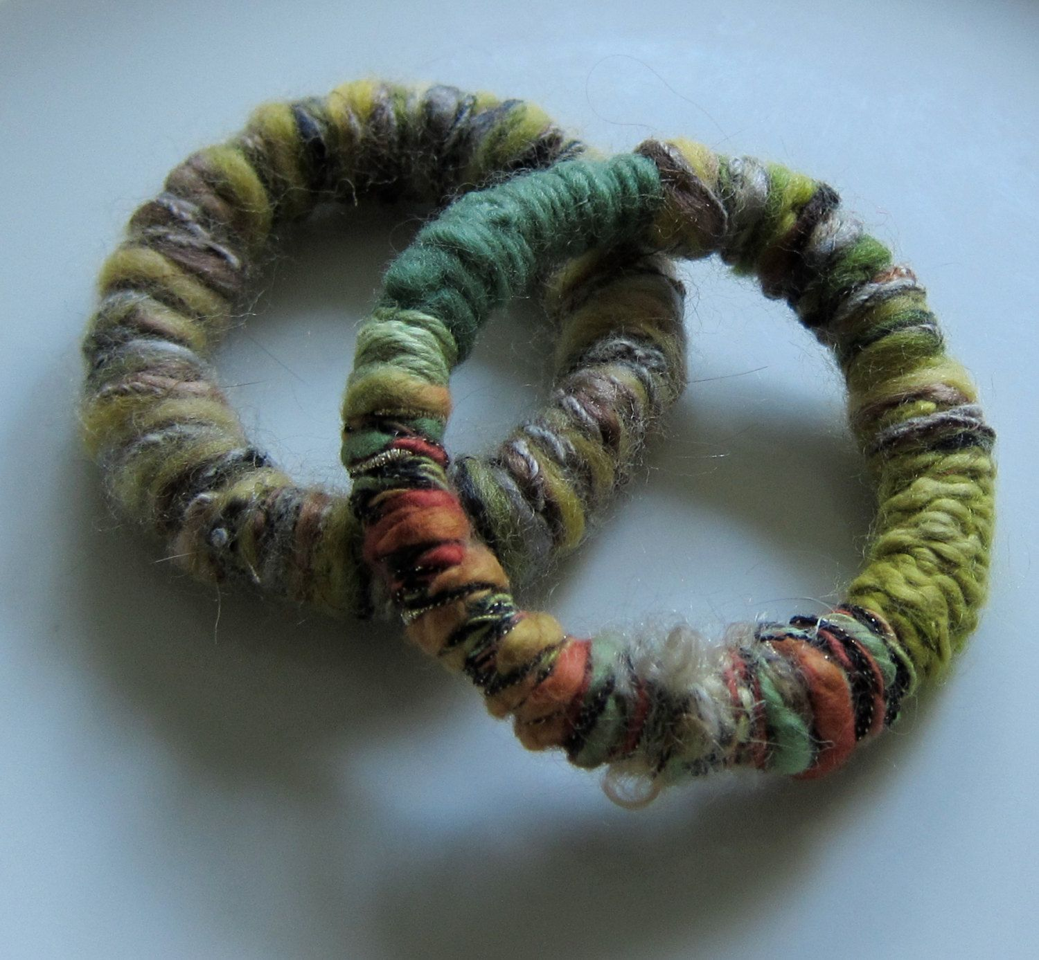 Soft Yarn Wrapped Bracelets Bangles in Shades of Green Eco-Chic. $14.00, via Etsy.