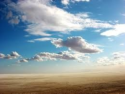 Clouds hint at bringing rain to parched desert below..