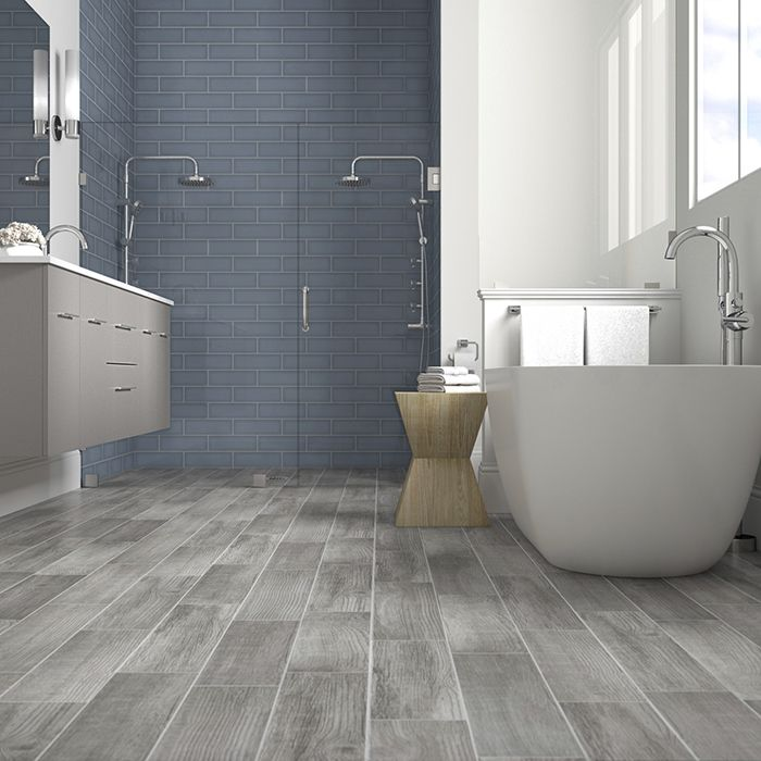 French blue shower tile with gray woodlook floor tiles