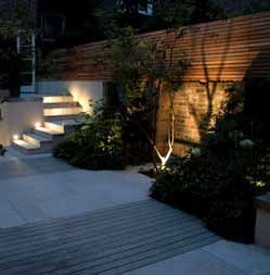 Landscape lighting needs to be both beautiful and functional. This well lit staircase is safe and stunning! #landscapelightingdesign