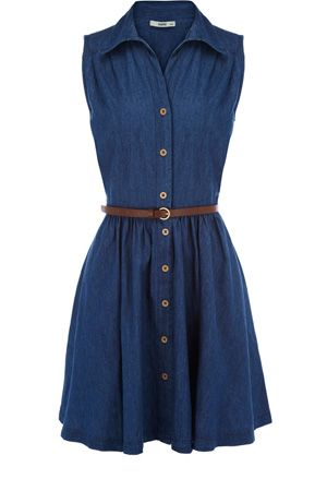 50120c45d37 This classic shirt dress has buttons down the front and a belt to fasten  the waist. With a cute collar to finish, this piece is sleeveless in style  and ...