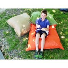 Relax and Learn with Outdoor easy wipe clean cushions, 90cm x 90cm, pictures show student on cushion outdoors