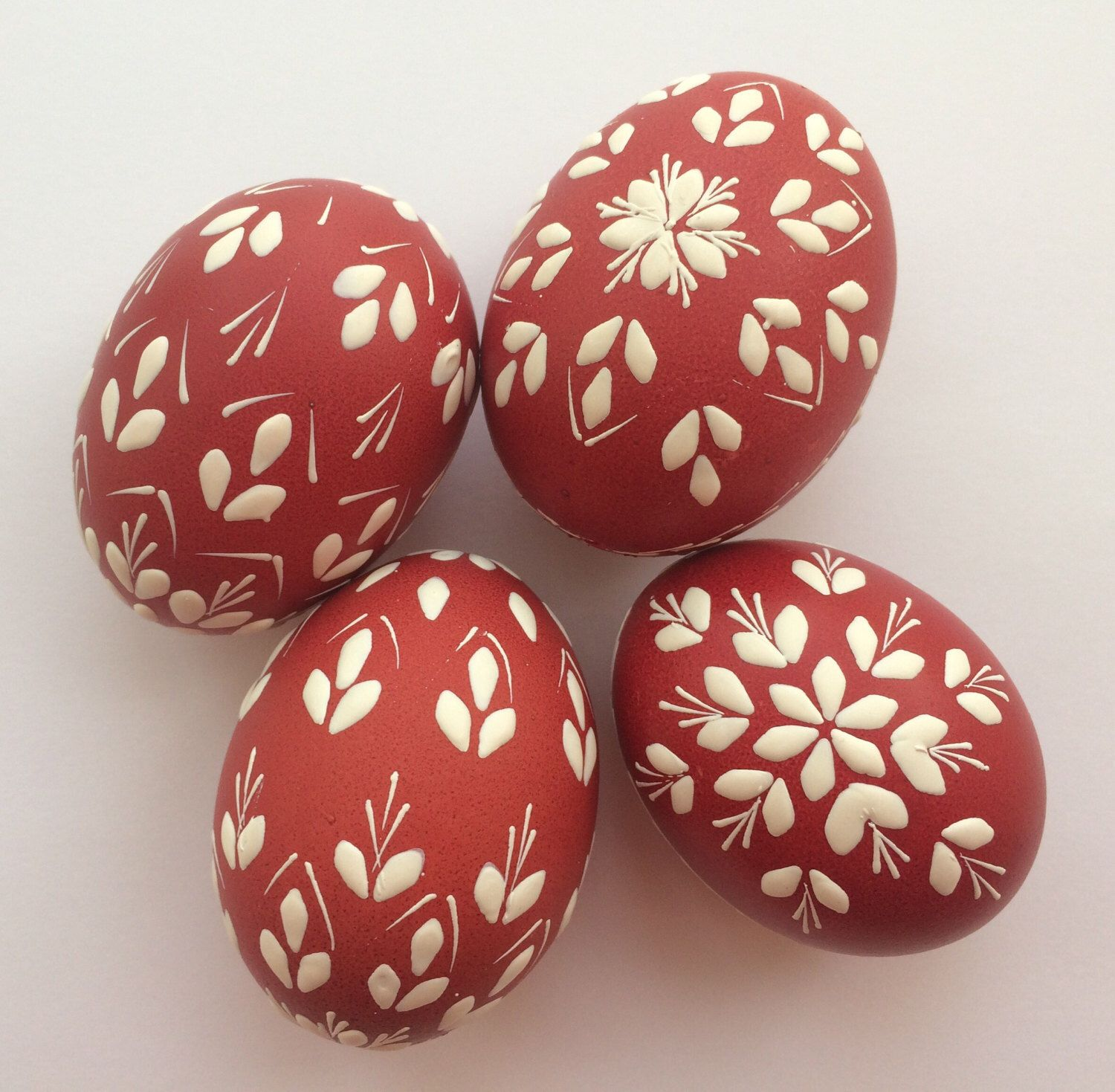 A personal favourite from my Etsy shop https://www.etsy.com/uk/listing/496823838/hand-painted-easter-eggs-red-and-white
