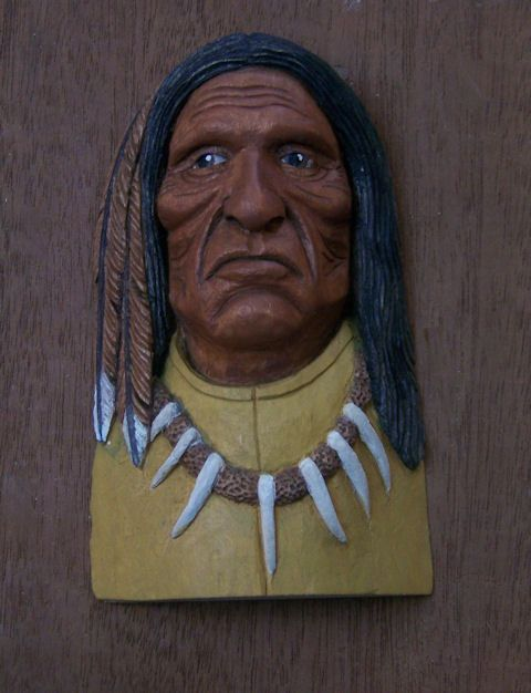 "Native American carving, Basswood, dilute Acrylics. 4-1/2"" x 2-1/2""  ""He who sees Horses"""