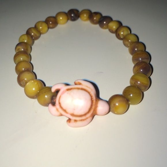 Medium- 7' stretchy turtle bracelet Medium- 7' stretchy, pink turtle with brown marble beads Jewelry Bracelets