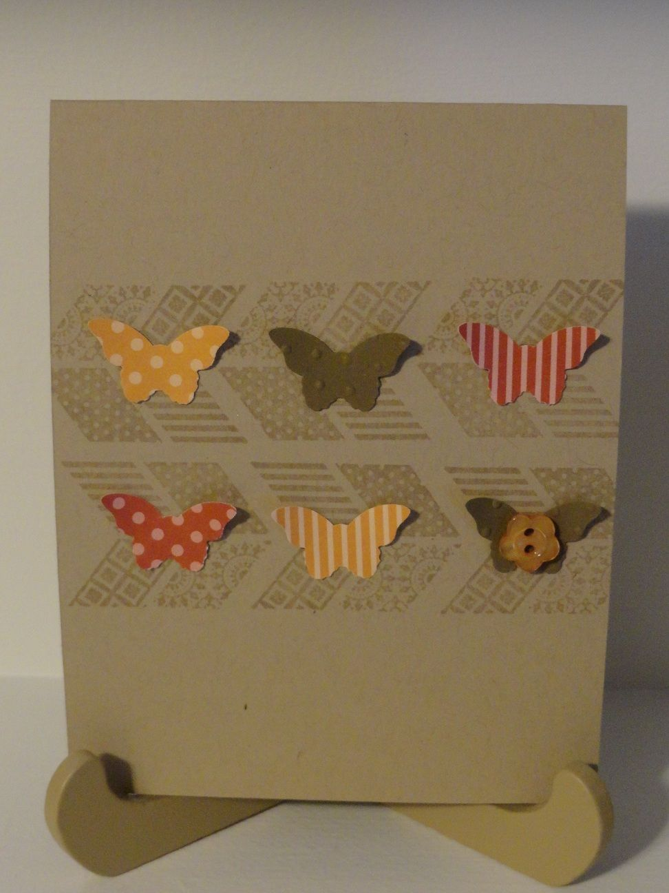 Stampin Up butterfly punch - Oh, Hello stamp set in background in versaMark
