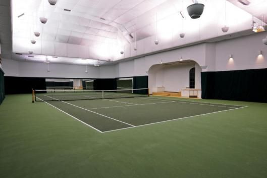 Of course no dream house would be completed without a tennis court. AN INDOOR TENNIS COURT!