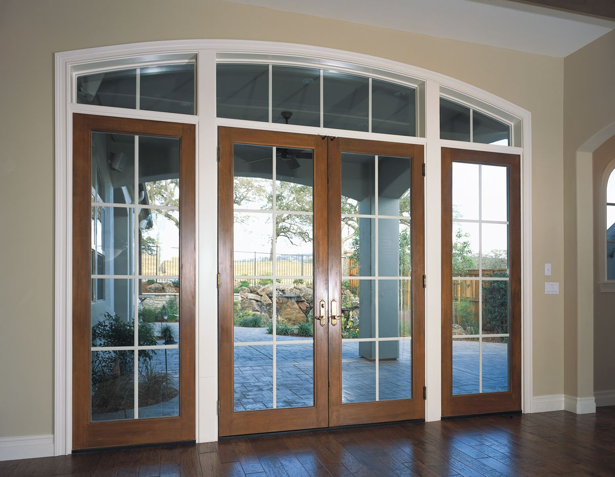 White and wood colors frame these french doors with large grids white and wood colors frame these french doors with large grids rubansaba