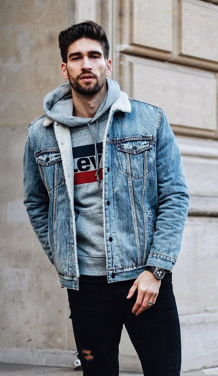Grey Levi Hoodie Over Denim Jacket And Paired With Black Ripped Jeans Denim Jacket Men Jean Jacket Outfits Men Hoodie Outfit Men