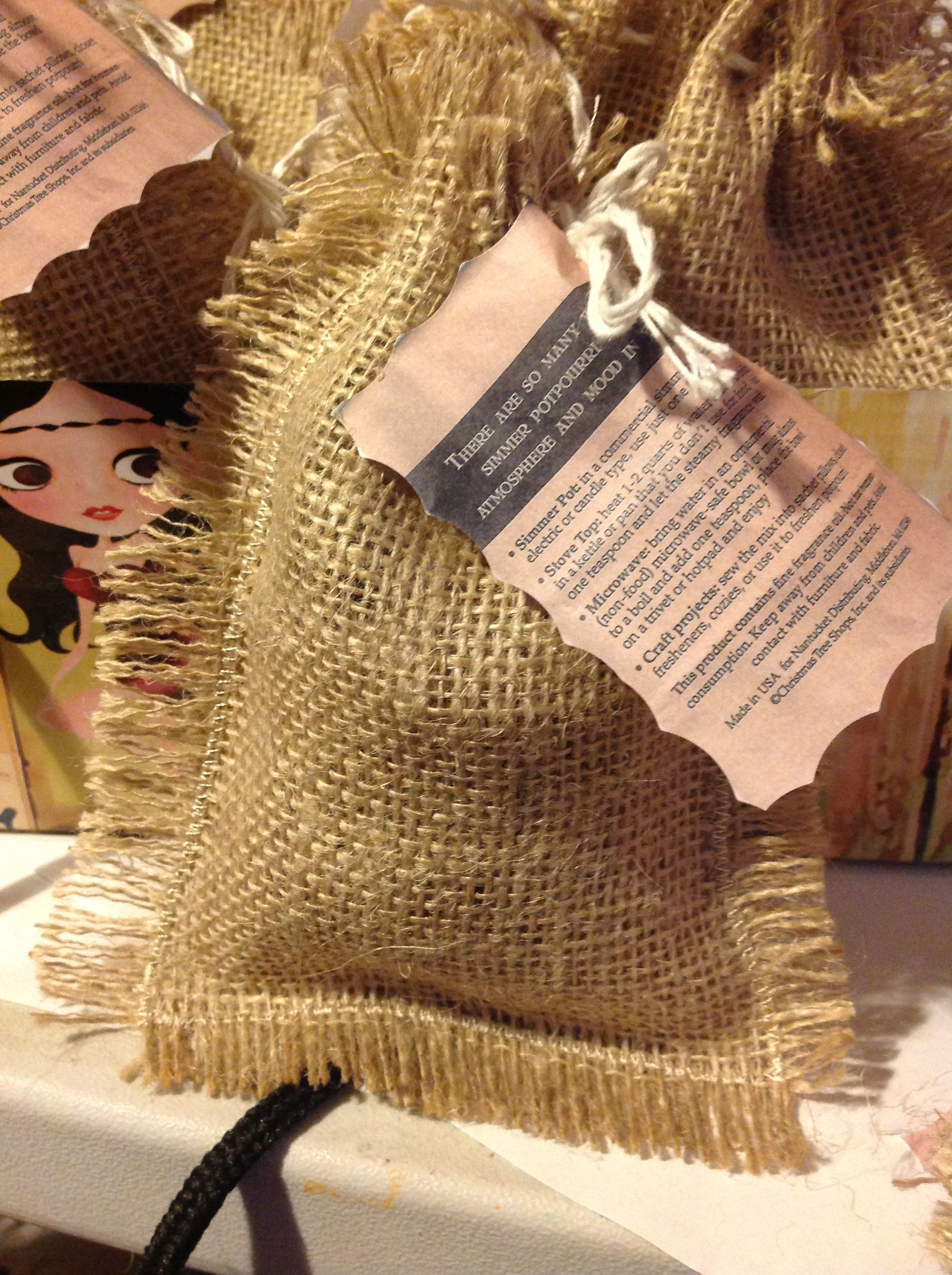 Raffia Bags Filled With Potpourri Favors For The