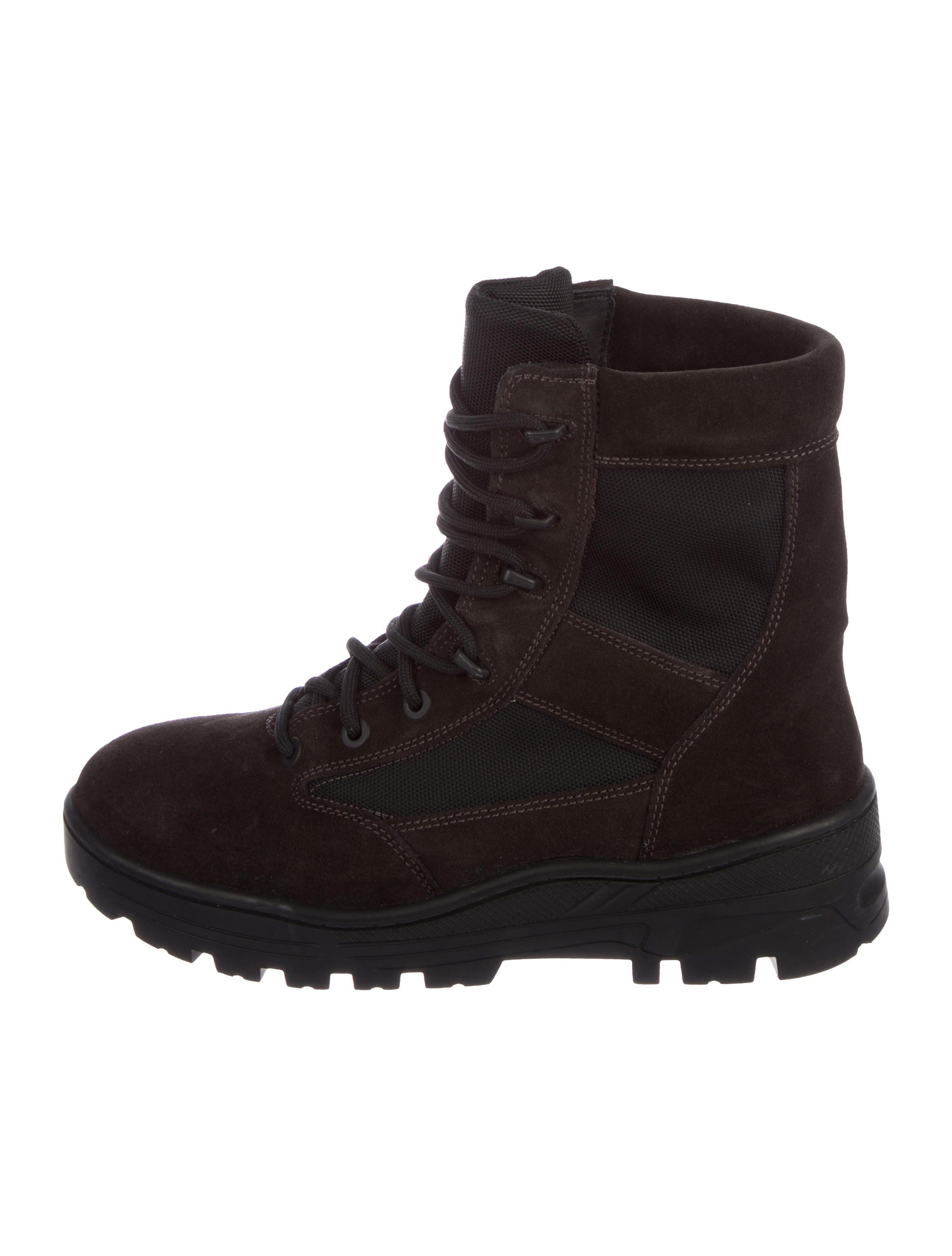 af0026cab96 Men s chocolate canvas and nylon Yeezy round-toe military boots with rubber  soles and lace-tie closures. Includes box and du