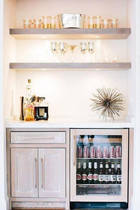 Fantastic bar nook is filled with gray wash floating shelves ...