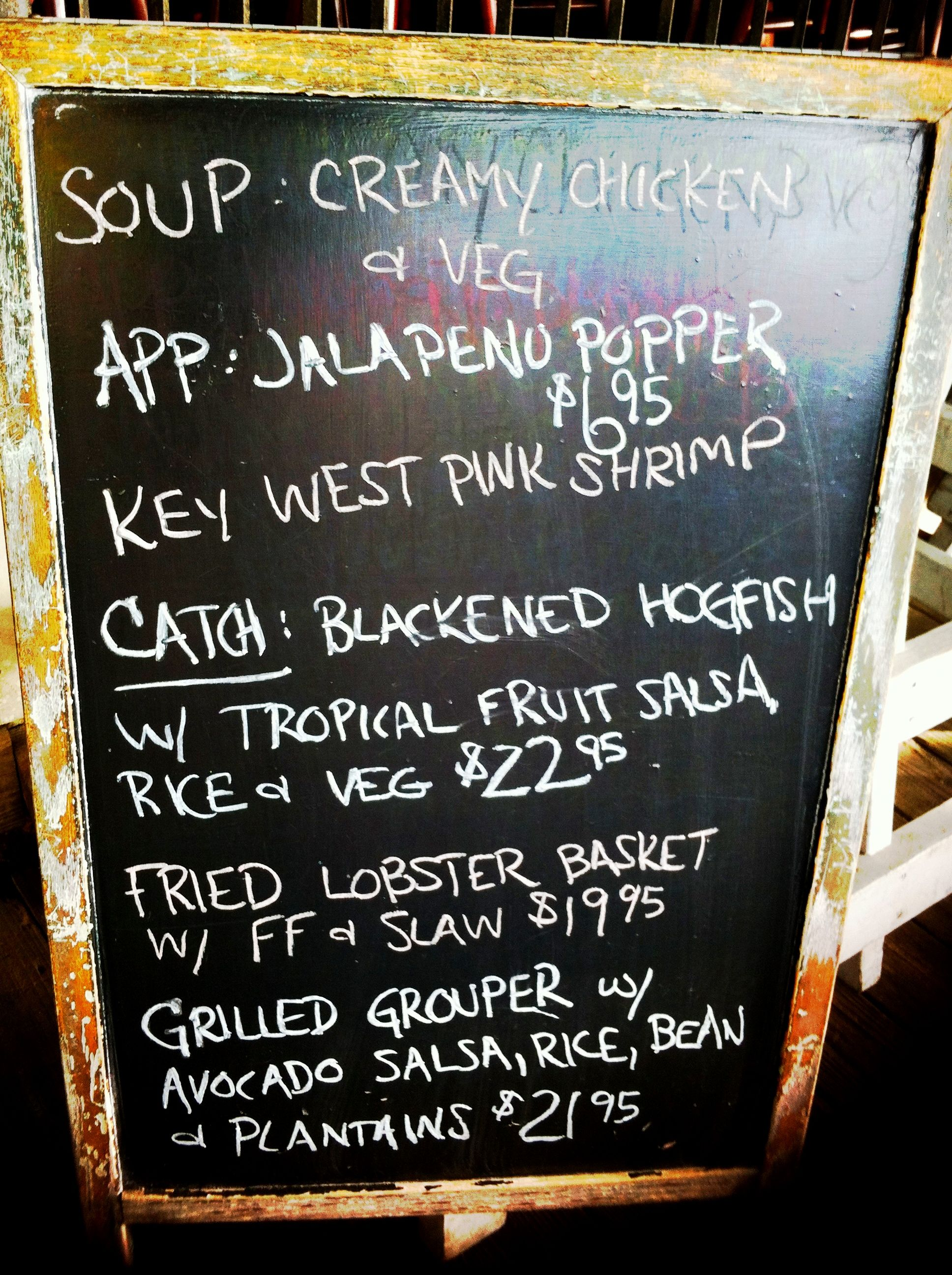 Having lunchblackboard menu, Key West, Florida