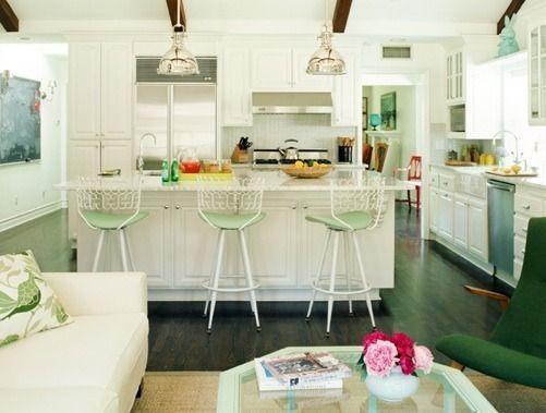 Mint green kitchen. Love the industrial lights. Shelf above the kitchen sink window. Beadboard above range.
