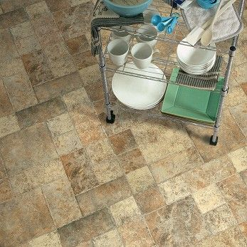 Charmant The Genuine Looking #tile Pattern Showcases The Appearance Of Textured,  Weathered Stone With · Laminate FlooringFlooring ...