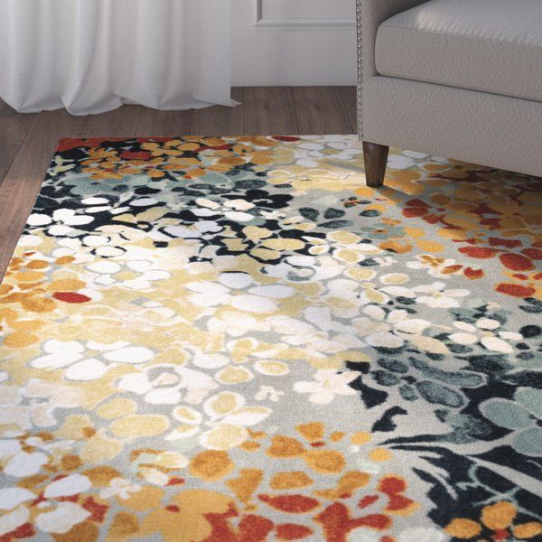 Add Excitement To Your Space With The Brightly Colored Abstract Floral Design Printed On The Same Machines Th Family Room Design Area Rugs Rugs In Living Room