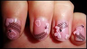 Pinks nails with crisscross design
