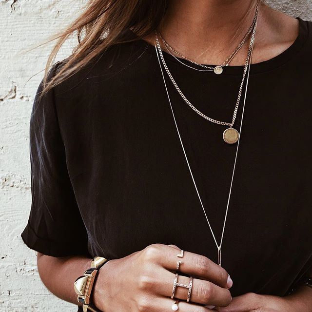 A black tee paired with layered jewelry is so stylish.