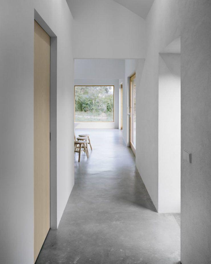 Minimalist interior design with concrete floors and ...