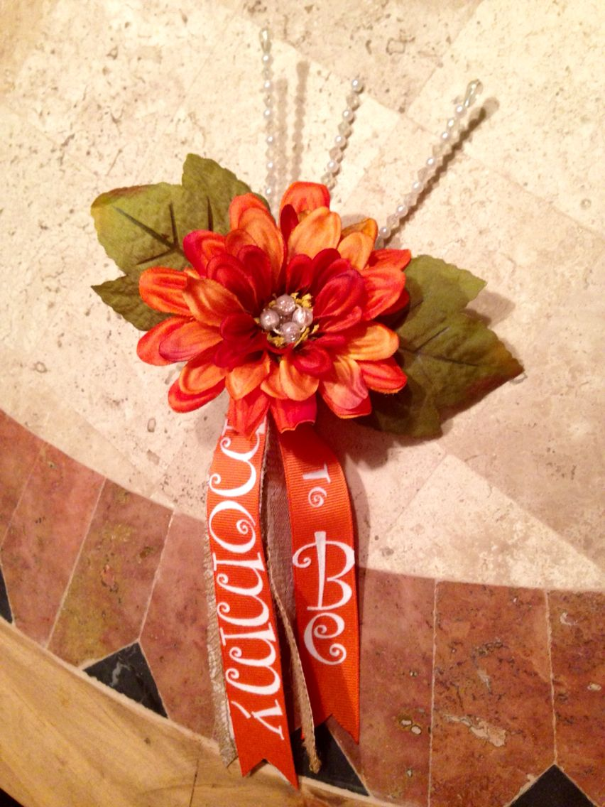 Courtney's corsage is all done and very happy with it. Cost me about $2