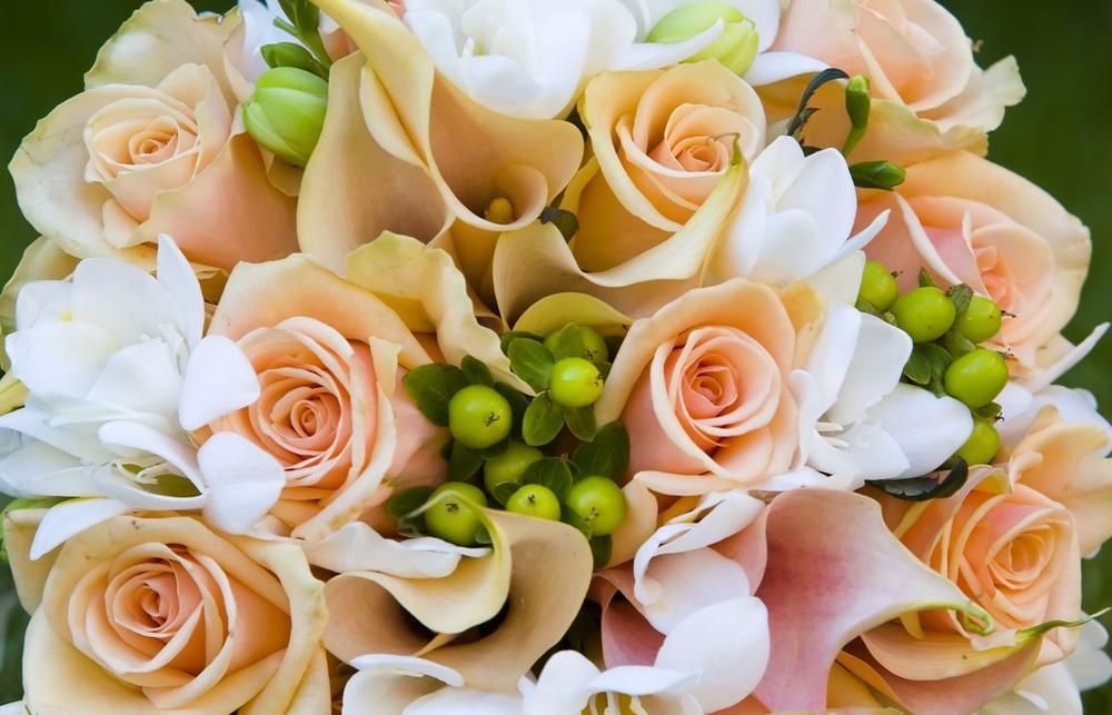 A Pale Orange Bridal Bouquet Featuring Roses Ideal For Spring Wedding