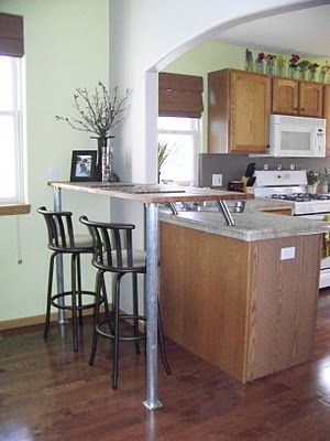 ikea kitchen bar rustic tiles diy breakfast using part of an wood counter top stainless steel supports and large conduit legs from home depot