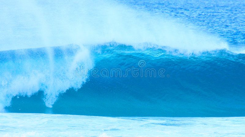 Blue wave breaking with spray ad wave blue spray