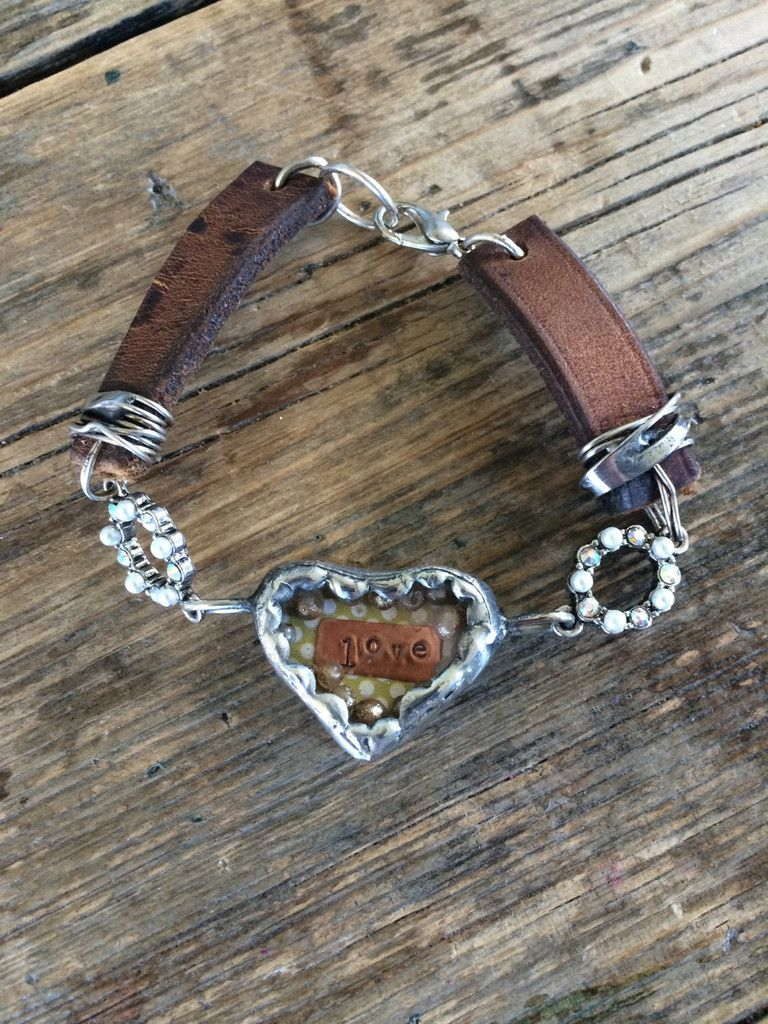 This is a beautiful handcrafted Leather bracelet with a soldered glass heart. Inside this heart there are vintage pearl beads that float around inside along wit