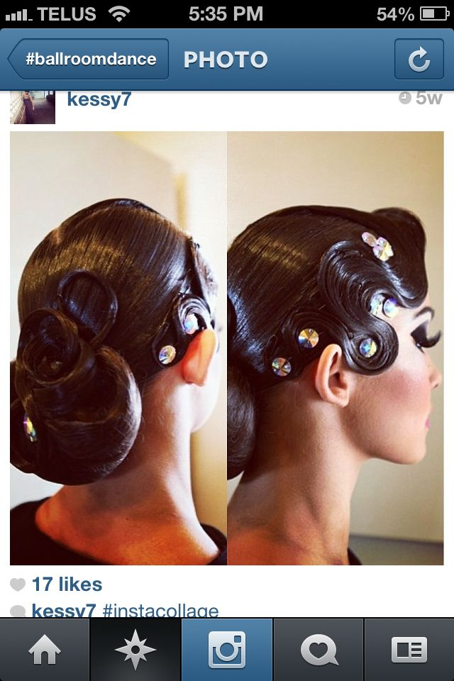 Large bun with swirls and a large front wave with rhinestones. This hairstyle can work for both Standard and Latin. Visit http://ballroomguide.com/comp/hair_make_up.html for more hair and makeup info