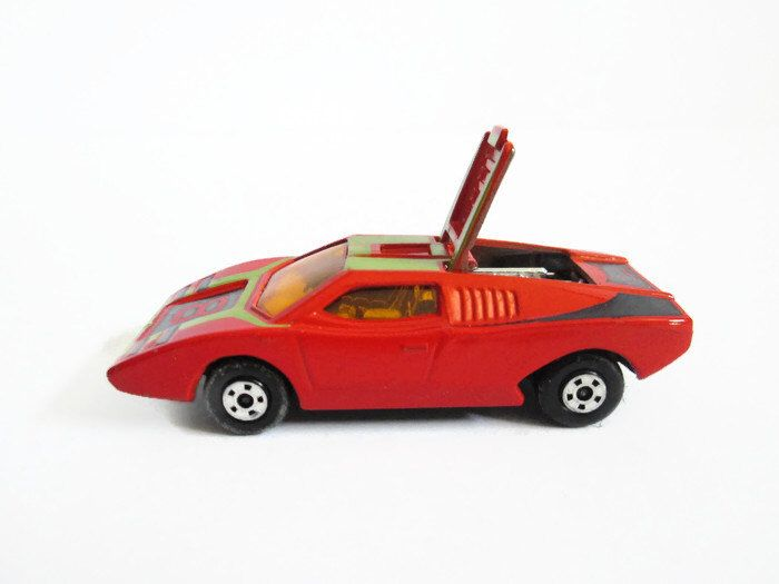 1973 Lamborghini Countach No. 27 Vintage Toy Car, Matchbox Superfast, Made in England by Lesney, 1970's Toy Car, Orange Red Racing Vehicle by jpjcandyland on Etsy https://www.etsy.com/listing/231423985/1973-lamborghini-countach-no-27-vintage