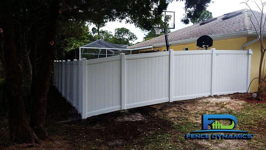 Vinyl Picket Fence On Slope Racking Vinyl Picket Fence Backyard Fences Fence