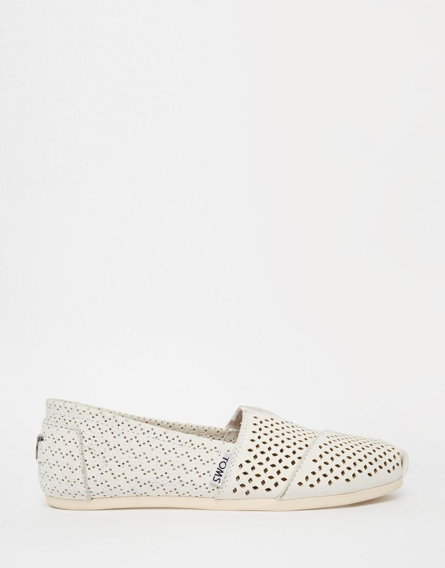 130a06693b4 Image 1 of TOMS White Perforated Leather Slip On Shoes