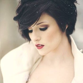 I adore the color and the cut. The makup reminds me of a modern day Snow White. This is what I personally would like to look like every day if I could.