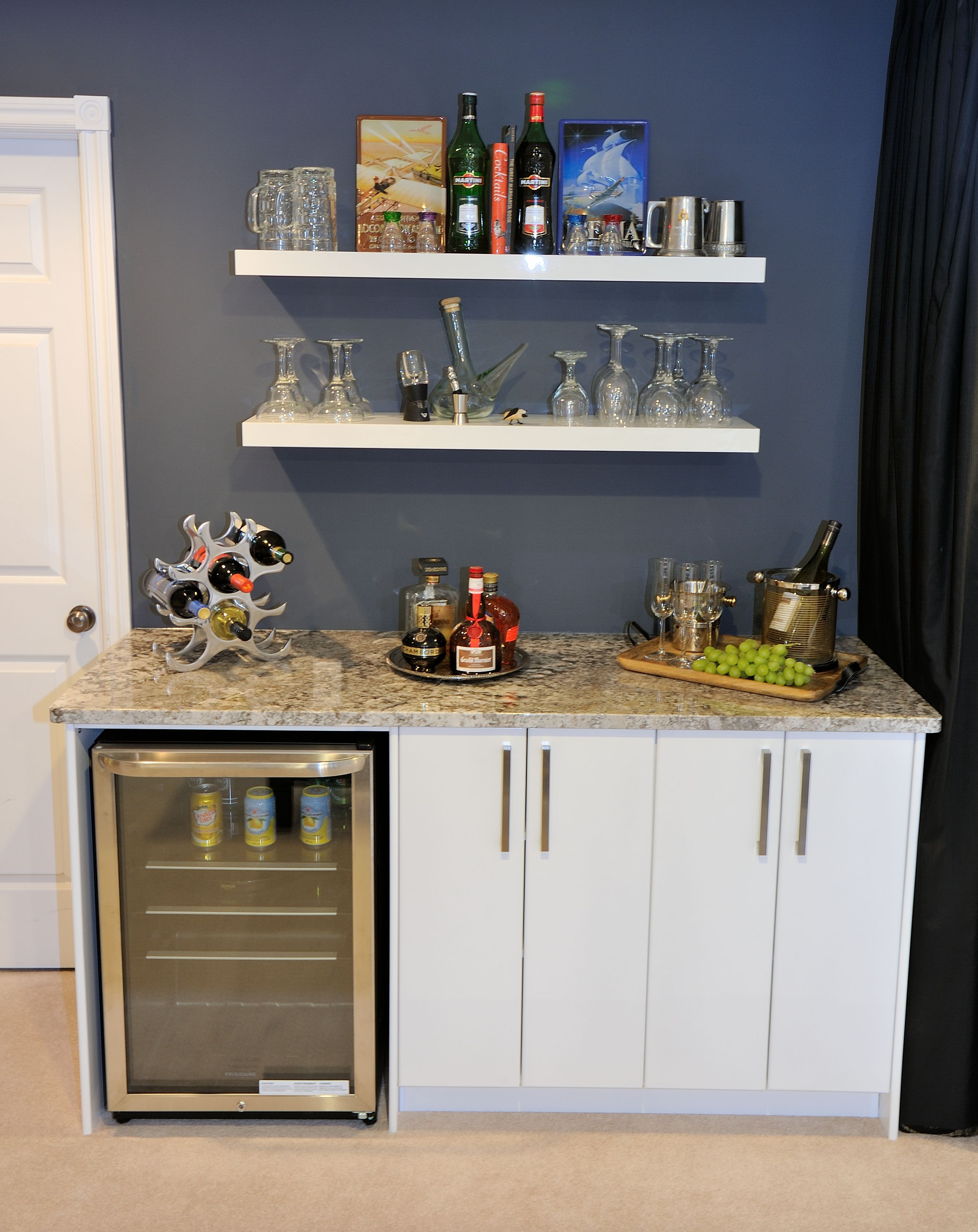 Built In Custom Cabinets With Bar Fride, Beautiful Granite Countertop,  Floating Shelves