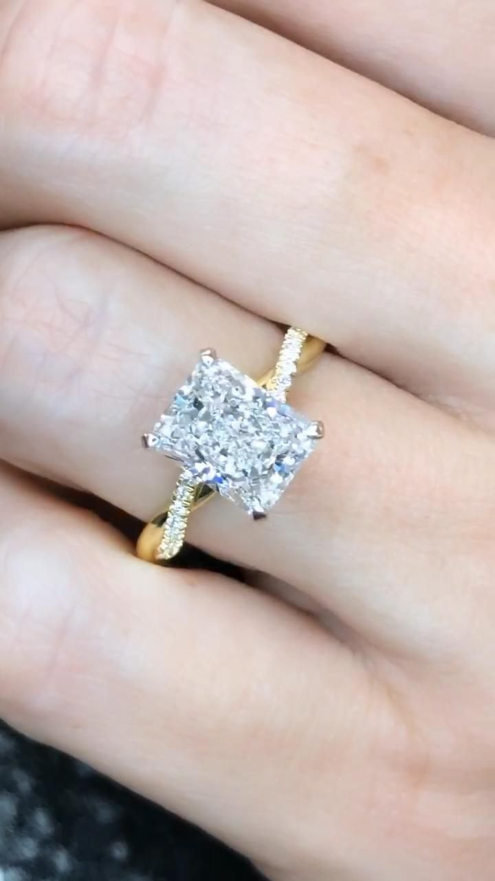 Unique custom diamond engagement ring featuring a radiant cut diamond on twisted diamond band. Handcrafted by Ascot Diamonds Atlanta