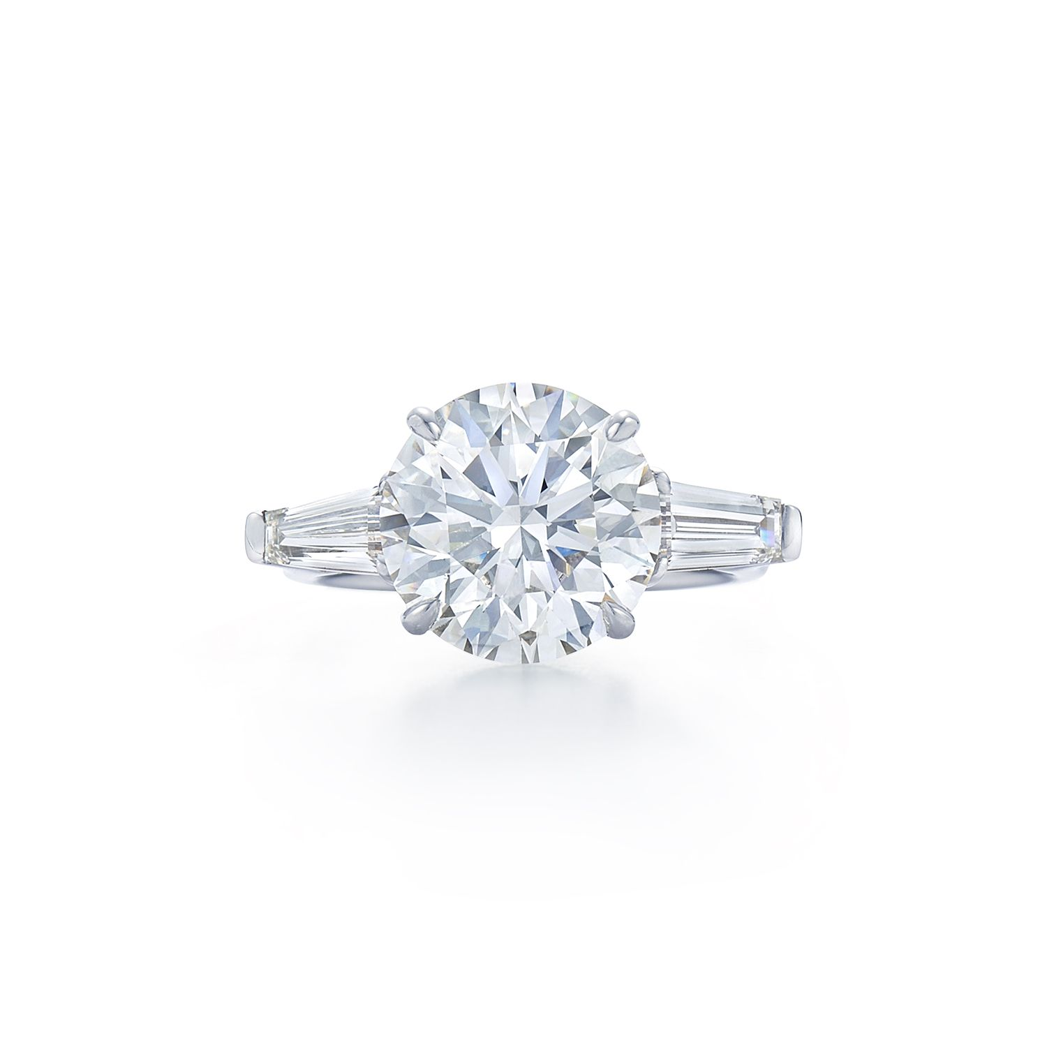 round brilliant diamond ring with tapered baguette side stones