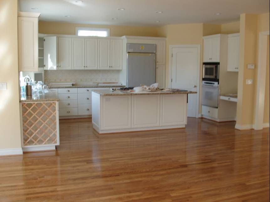 Oak floors with white cabinets this picture is of a new for White cabinets white floor