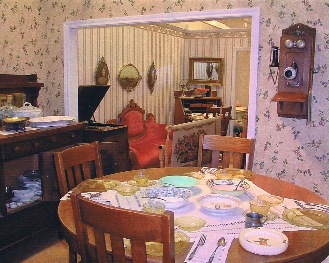 1920s dining area - i like the stripe wallpaper in one room, floral wallpaper in the other