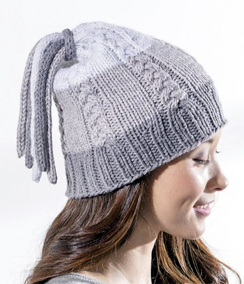 8c121cb46a5 Free Knitting Pattern for Tassel Hat - Cabled hat topped with a tassel made  from i-cords. Takes one skein of the recommended self-striping yarn.