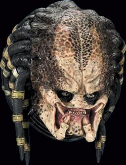 Predator - The Warrior Hunter from another world! This unique latex mask offers some separate dreadlocks, deluxe paint job and closed mouth mandible so the included plastic Predator Helmet can fit into place.