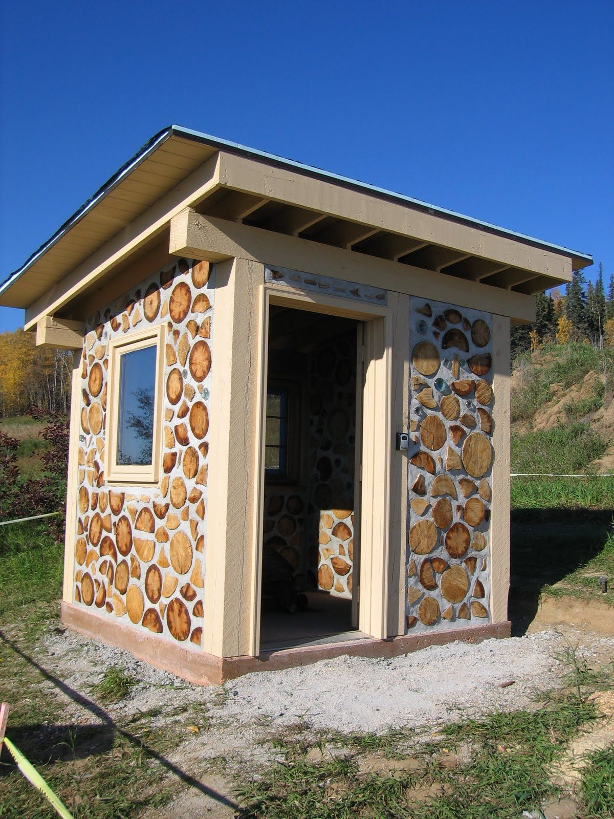 cordwood outhouse