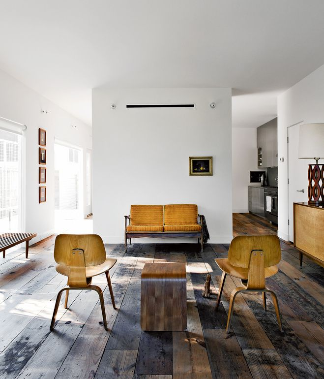 Walsh and Strongin's living room strikes a more rustic note. Photo by Jack Thompson.