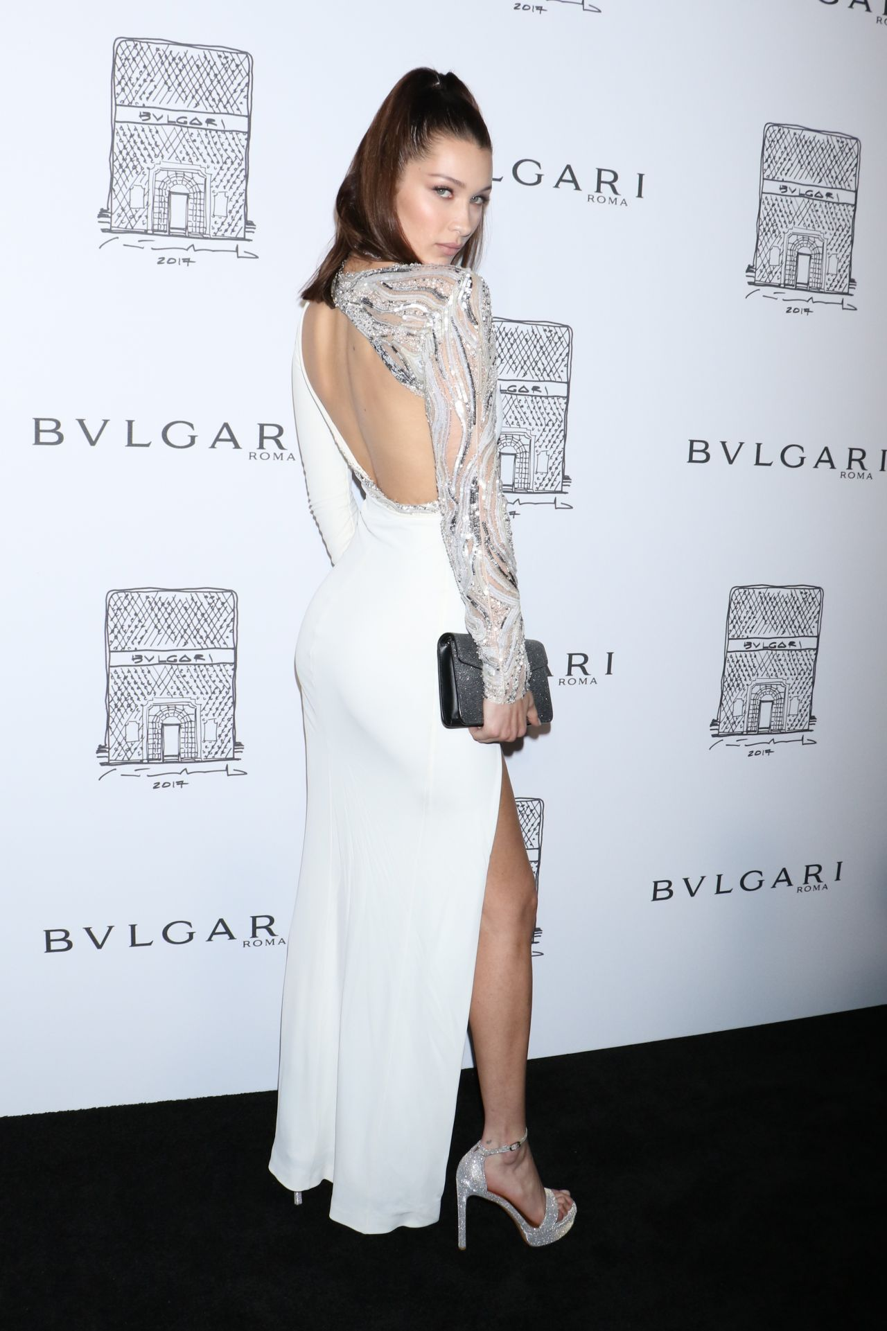 5be85072ec6 Bella Hadid attends Bulgari Celebrates 5th Avenue Flagship Store Opening on  Friday night (October 21) in New York City. She is wearing a Roberto  Cavalli ...
