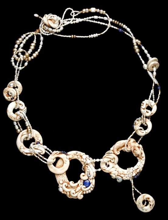 Going Around In Circles -- I've created dramatic adornments for a long time. I love them - when they are fastened around a neck, the wearer gets to participate in the exhibition of the art. What fun.