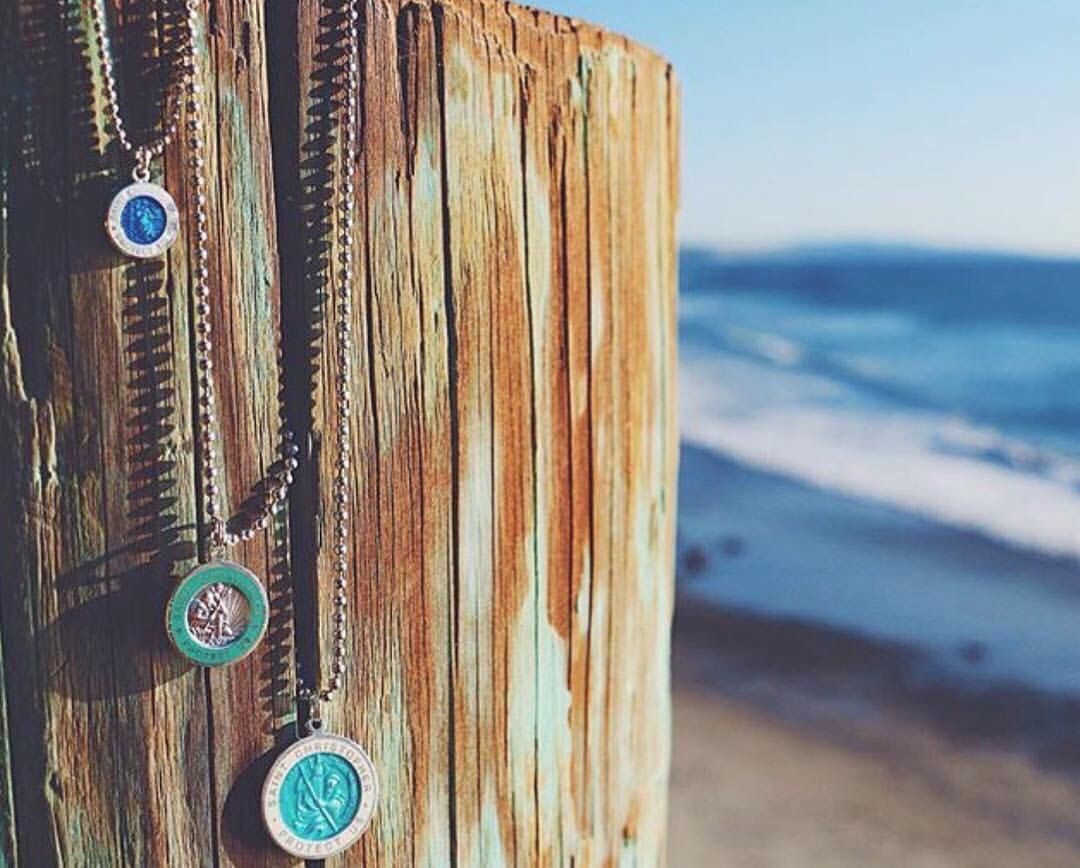 2d2629ad3e97c The Saint Christopher surf necklace, worn for protection during your ...