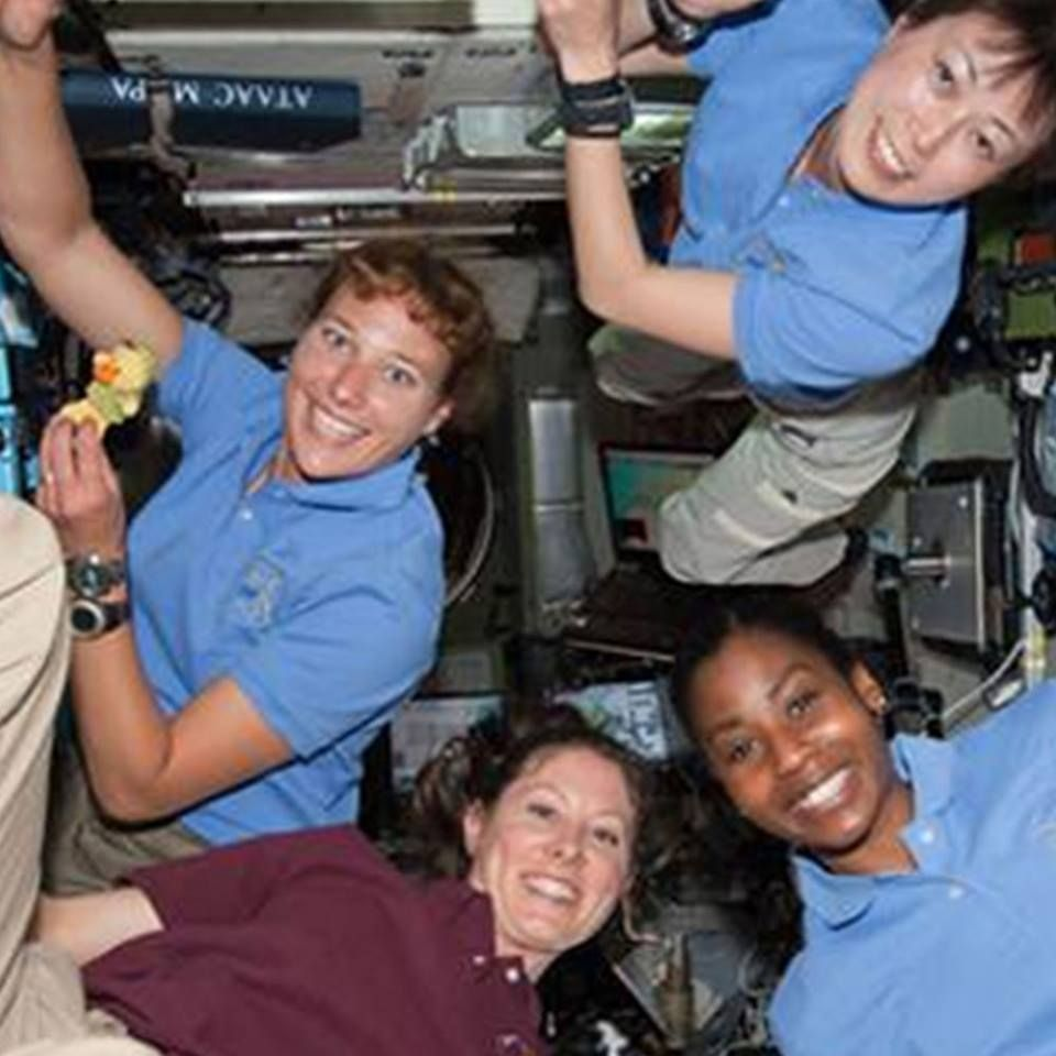 The record number of women simultaneously in space is four.  Those women were NASA astronauts Dorothy Metcalf-Lindenburger, Stephanie Wilson, Tracy Caldwell Dyson, and Japan Aerospace Exploration Agency (JAXA) astronaut Naoko Yamazaki.