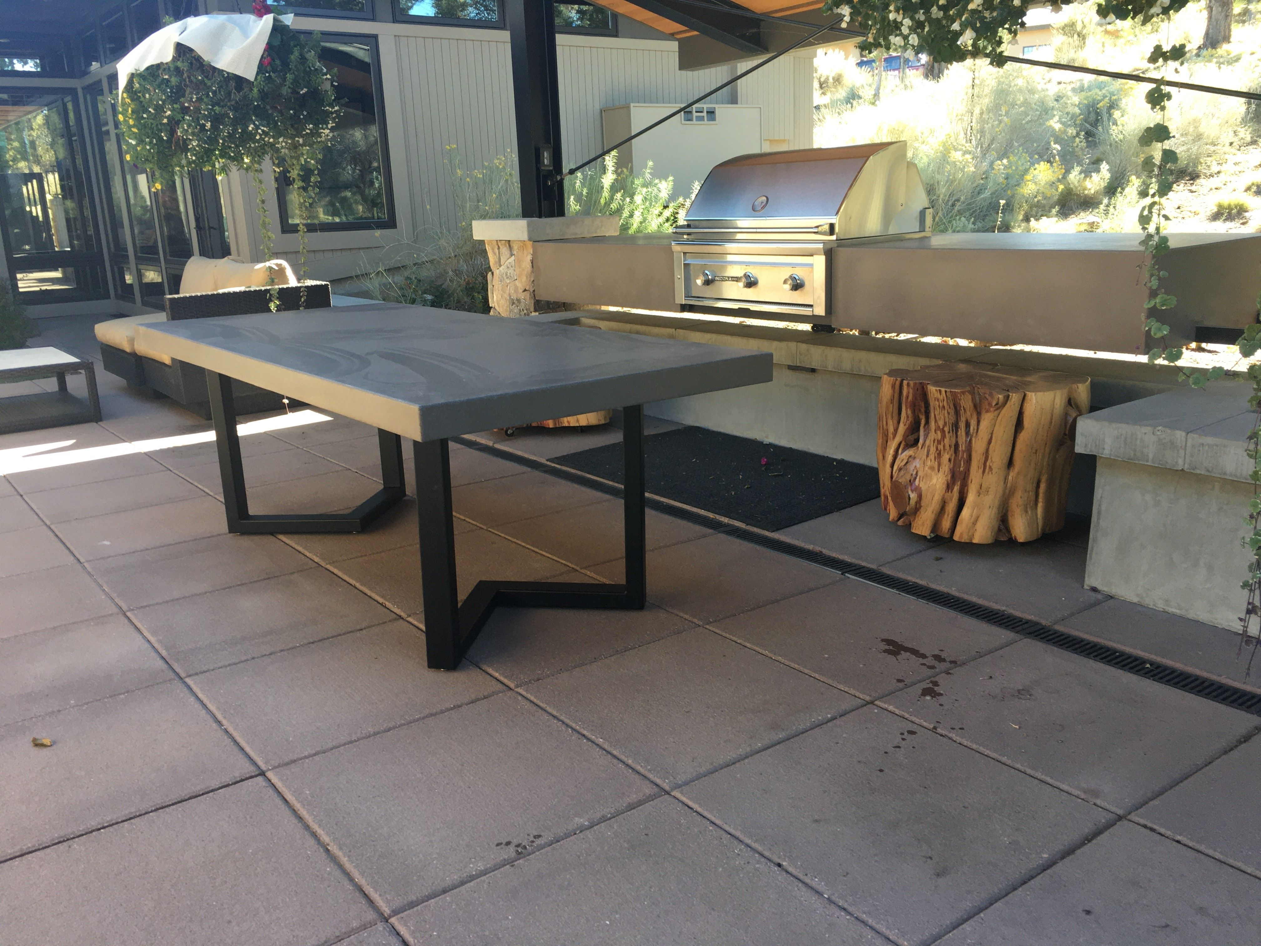 outdoor kitchen with concrete table top and counters let