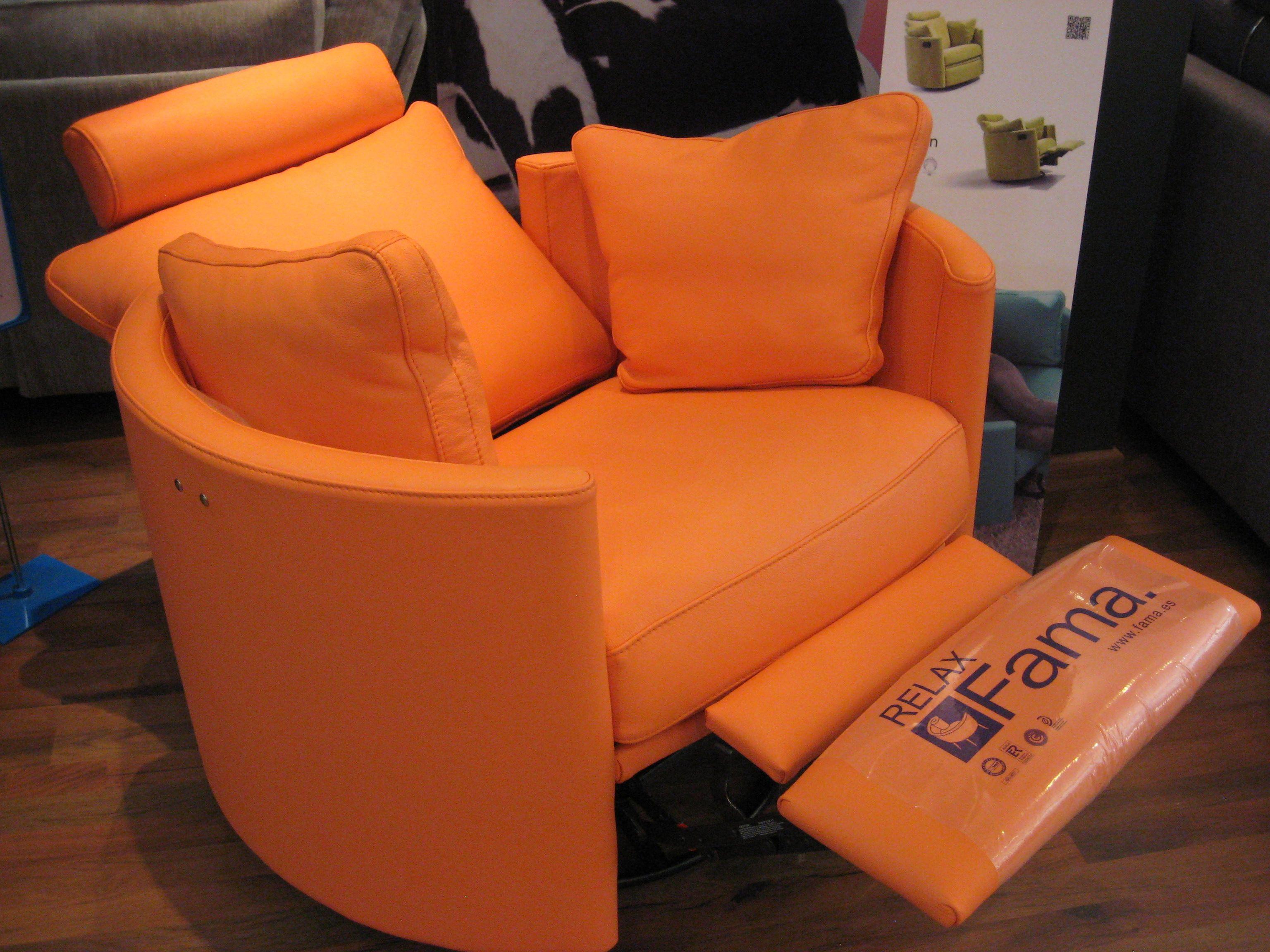 Fun orange leather on our designer curved swivel rocking