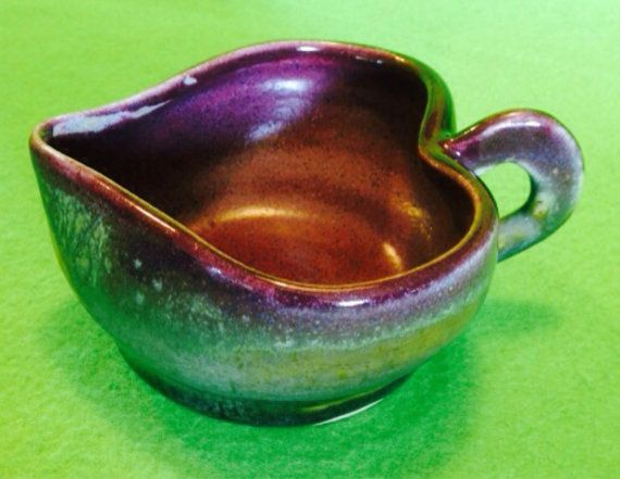 Handmade Heart Pottery Mug Gravy Boat RM47 by OneGreenAcre on EtsyBeautiful hand thrown cup or gravy boat! Glazed with Santa Fe Glazed base and topped with Purple glaze.From above, you see the heart shape of the cup!