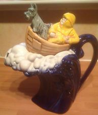 Riding the waves, man and dog teapot